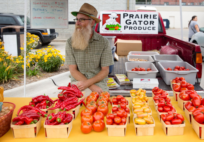 OMAHA, Neb. --Steve Kunasek runs his Prairie Gator Produce booth during Dundee Day on Saturday, August 29, 2015 in Omaha. The festival featured games, vendors, a parade and an evening beer garden. SARAH HOFFMAN/THE WORLD-HERALD